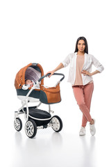 young woman with infant baby in baby carriage isolated on white