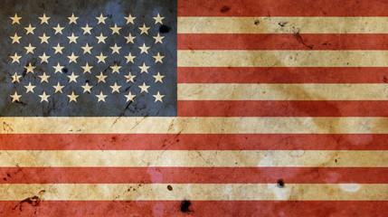 Old vintage American US flag over white wood