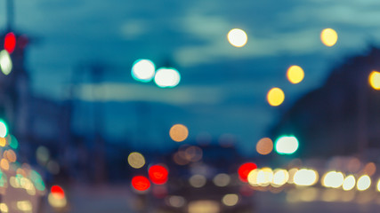 Blur traffic road with colorful bokeh light and old building town abstract background,retro tone.