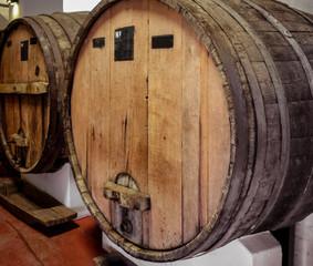 wood wine barrels in a winery