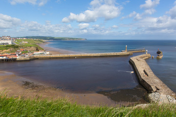 Wall Mural - Whitby harbour entrance and coast North Yorkshire England uk