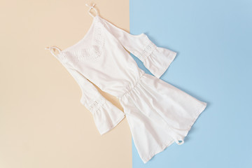 Female summer wardrobe. White overall with lace and sleeves. Fashionable concept