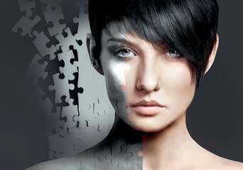 Female close-up portrait with jigsaw puzzle patch. Fashion style concept