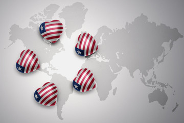 five hearts with national flag of liberia on a world map background