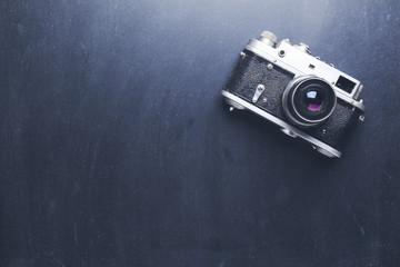 retro camera on dark table background