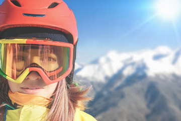 Snowboarder girl at Alps, Swiss mountain. Winter activities