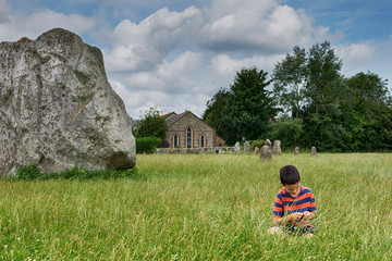 Child at stone circle site in England, Avebury.