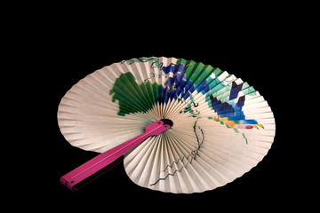 Closeup of Traditional Chinese paper fan on black  background.Hand paper fan