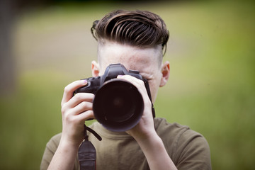 Close-up of teenage boy photographing