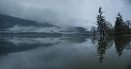 Scenic view of lake against mountains during foggy weather at Olympic National Park