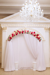 The wedding photographer's area is decorated with tulle and flowers
