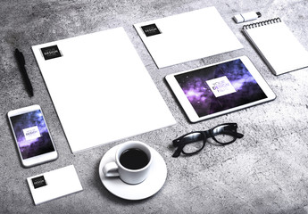 Corporate Identity Set with Smartphone and Tablet on Concrete Background