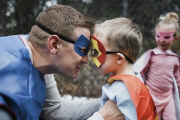 Close up of family dressed in superhero costume