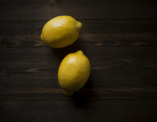 Overhead view of lemons on wooden table