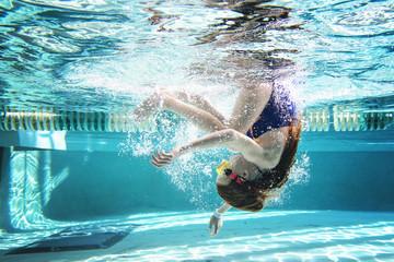 Full length of girl swimming underwater in pool