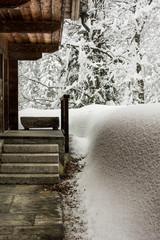 Alpine lodge covered of snow