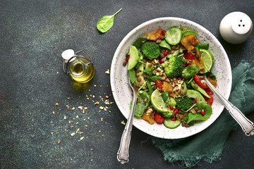 Detox spring salad from green vegetables (avocado, cucumber, broccoli and baby spinach).Top view.