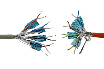 Two twisted pair STP network copper cables standing against each other.