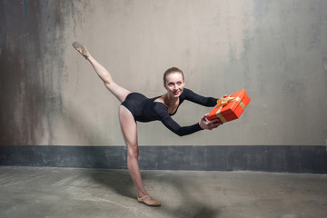 Young adult ballet dancer present gift box for you