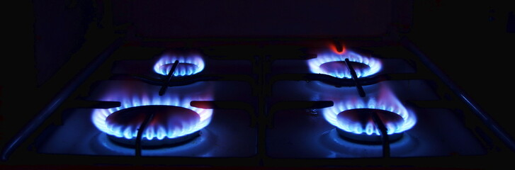 Natural Gas. Blue flames of gas burning from a kitchen gas stove. Russian gas.