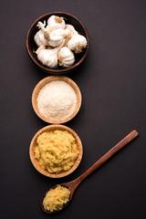 dried granulated garlic powder and garlic paste, selective focus