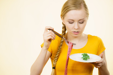 Sad young woman being on diet