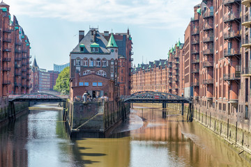 HAMBURG, GERMANY - JULY 20, 2016: Famous water castle in Speicherstadt. Hamburg attracts 10 million people annually