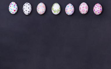 Easter eggs painted on black.