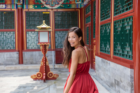 Asian beauty woman healthy lifestyle portrait. Mixed race girl in old chinese temple, tourist attraction, china travel vacation. Summer holidays.