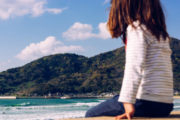 little girl watching the sea in japan