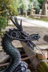 japanese shrine purification fountain in dragon shape