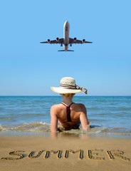 Caucasian girl with hat on the beach. The plane landing on a tropical island. Summer vacation by the sea.