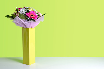 Bouquet of spring flowers in vase. Valentine's or Mother day background with copy space.