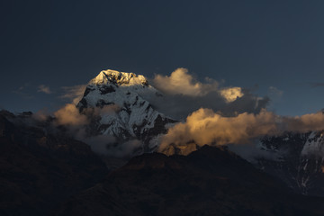 Landscape with Annapurna South peak view from Tadapani during trekking in Himalaya Mountains, Nepal