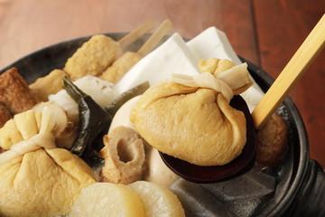 おでん Japanese oden. vegetables, fish dumplings and various other articles of food stewed in a thin soy soup.