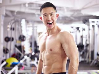 portrait of a happy asian bodybuilder