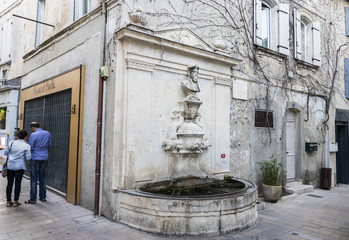 Water fountain with a bust of Michel de Nostradame or Nostradamus in the Old Town of his hometown and birthplace of Saint-Remy-de-Provence, France