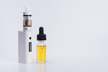 electronic cigarette with liquid for vapor on a light background