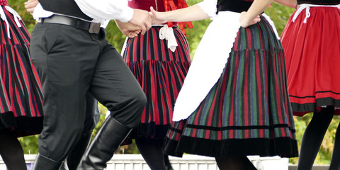 Folk dancer boys and girls in black, red and white - thematic background