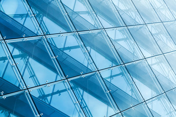 Curtain wall made of blue toned glass and steel