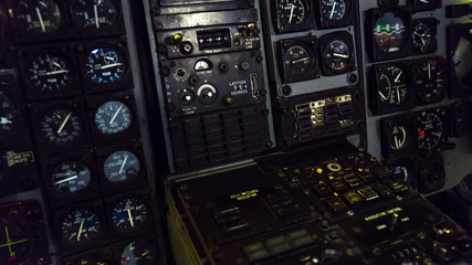 Close up of the inside of a military airplane dash board panel.