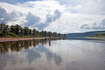 fishermen on the river