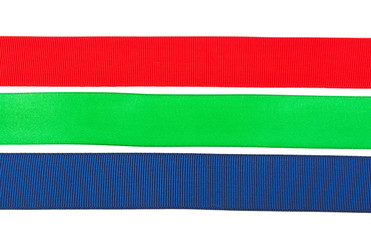 textile ribbons red blue green on white background