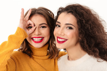 Close up image of two girls in sweaters having fun