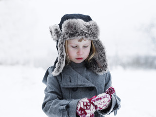 Girl in woollen clothes