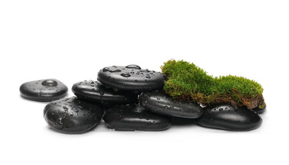 Green wet moss with black spa rocks and drops of water isolated on white background