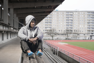 Man sitting on stadium bench
