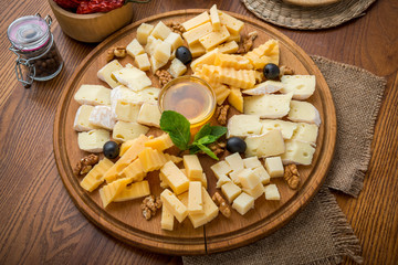 Assorted cheeses with honey and nuts