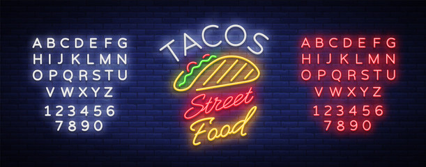 Tacos logo in neon style. Neon sign, bright billboard, nightly advertising of Mexican food Taco. Mexican street food. Vector illustration for your projects, restaurant, cafe. Editing text neon sign Wall mural