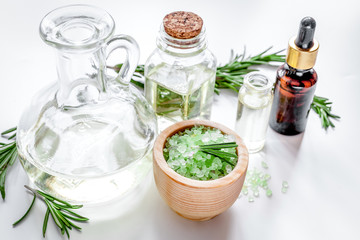 organic cosmetics with extracts of herbs rosemary on white backg
